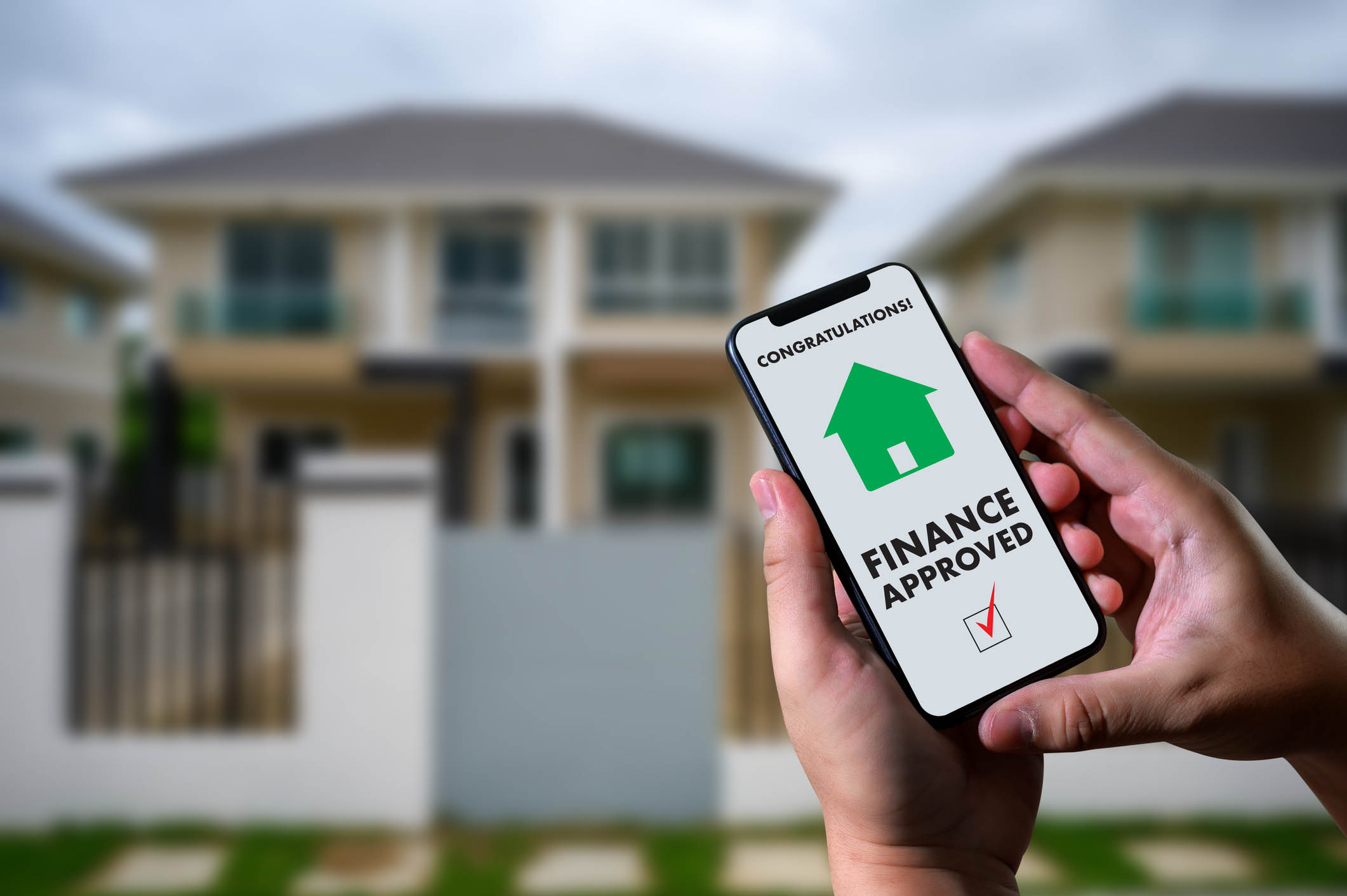 finance loan agreement and house key Mortgage Loan approval on mobile phone in a house